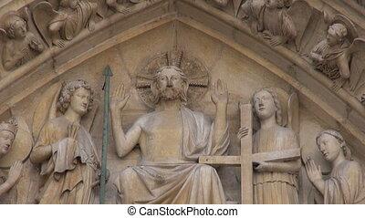famous Notre Dame cathedral facade - Paris, France - famous...