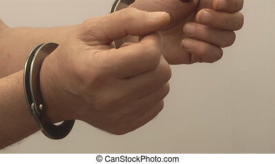 Handcuffs, - CRIME AND THE LAW