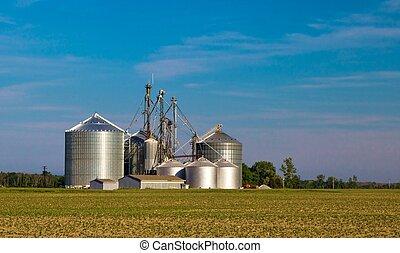 Grain Silos - Industrial size grain silos against a blue sky...