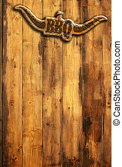 barbecue menu - barbecue insignia with horns on a wooden...