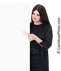 Young witch with a blank billboard over white background