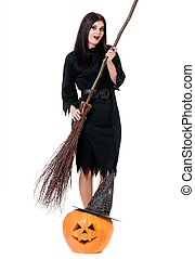 Young witch coquette with halloween broom and gourd isolated...