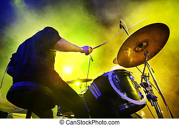 boy playing the drums. Live concert and stage lights. - Live...