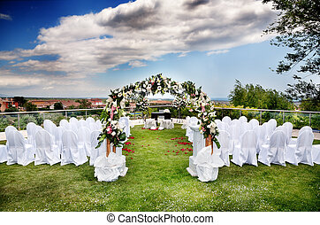 Outdoor ceremony - beautiful ceremony venue with flowers and...