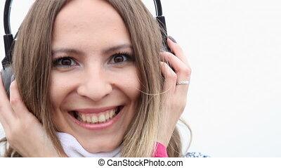 Woman headphones listening music - Flirty girl young woman...