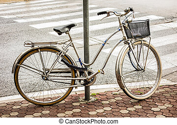 City bike - an old bycicle in a tranquil italian city