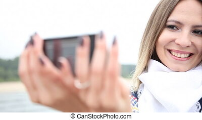 Woman taking photo of herself - Happy girl young woman...