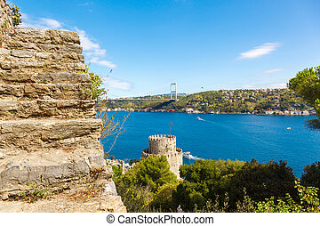 Rumelihisari fortress on a background of blue sky and Fatih...