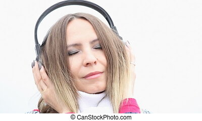 Woman headphones listening music - Relaxing girl young woman...