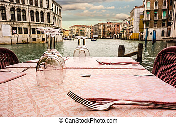Dinner in Venice - a romantic table set on the waterside in...