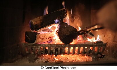Fireplace - Burning wood in stone fireplace