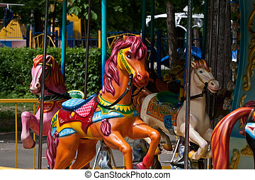 Merry-go-round - Multi-coloured horsies on a classical...