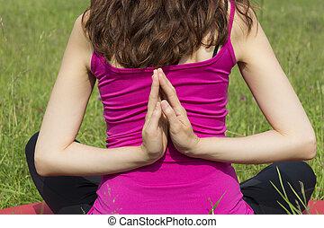 Woman in reverse namaste pose