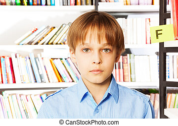Portrait of serious boy in the library