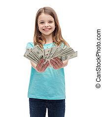 smiling little girl giving dollar cash money - money,...