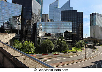 Modern buildings in the business district of La Defense to the w