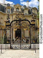 Palace with gilt gate on the Champs-Elysees. Paris.