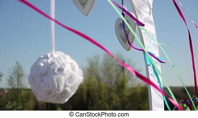 wedding arch - ribbons and decorations fluttering in the...