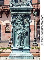 iron allegory at the fountain of justice in Frankfurt - iron...