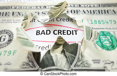 bad credit - Bad Credit text under a torn dollar bill...
