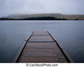 Twin Lakes boating dock fall rain Yukon Canada