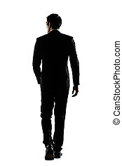 rear view of business man walk - Silhouette of Asian...