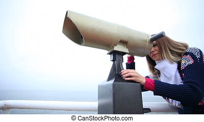 Woman looking through binoculars - Travel and tourism Woman...