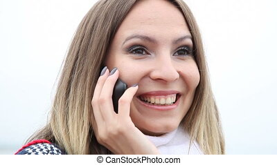 Happy woman talking on cell phone - Communication Happy girl...
