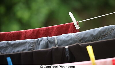 Clothes hanging to dry on line - Colorful clothes hanging to...