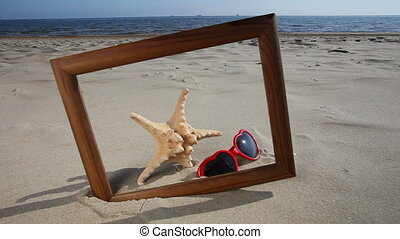 Frame with starfish and sunglasses