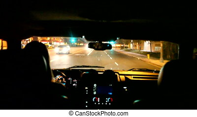 Timelapse of a Woman Driving Through the City at Night