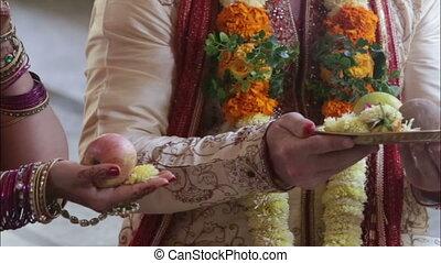 groom bride take fruit