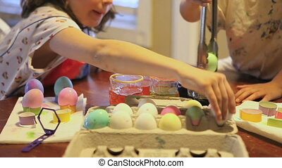 Kids Coloring Easter Eggs as a Holiday Tradition