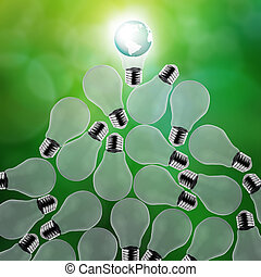 planet earth in a lightbulb as energy concept