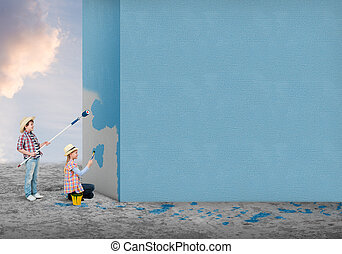 Home renovation - Cute little girl and boy painting the wall