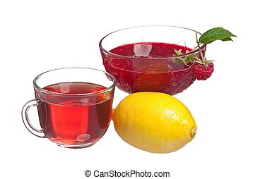 Anti-virus remedy - Glass cup with tea, raspberry jam and...