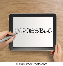 hand changing the word impossible to possible with stylus...
