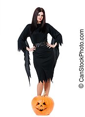 Sexy witch - Young sexy witch with halloween pumpkin over...