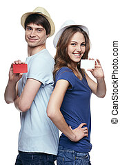 Happy couple showing credit cards - Happy couple in tshirts...