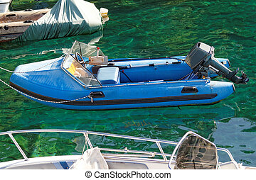 Motorboat  - Photo of a blue motorboat in the sea
