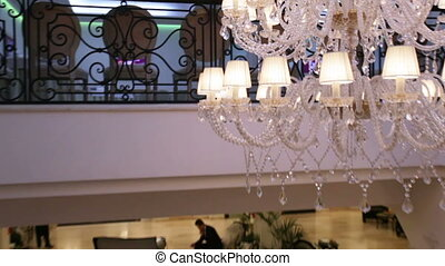 Chandelier over tree - Circling stairs and under chandelier...