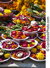 plates of flowers and candles - carpet of colorful plates of...