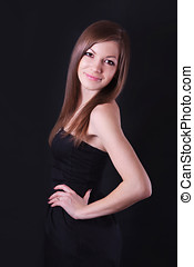 Portrait of a beautiful young woman in black dress