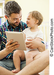 Father and daughter with tablet - Portrait of a happy father...