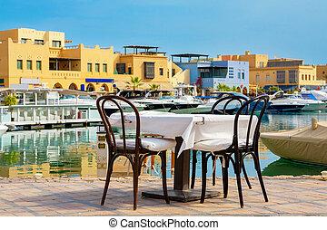Sidewalk cafe in Abu Tig Marina. El Gouna, Egypt - Table and...