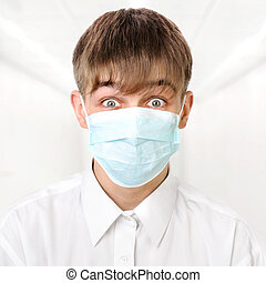 Teenager in Flu Mask - Fearful Teenager in the Flu Mask