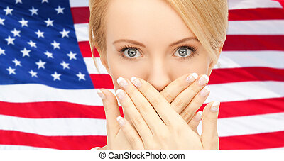 woman with hands over mouth - usa politics, conspiracy and...