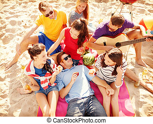 group of friends having fun on the beach - summer, holidays,...
