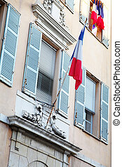 Buildings in Antibes - Building with shutters on windows and...