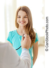male doctor with stethoscope listening to child -...